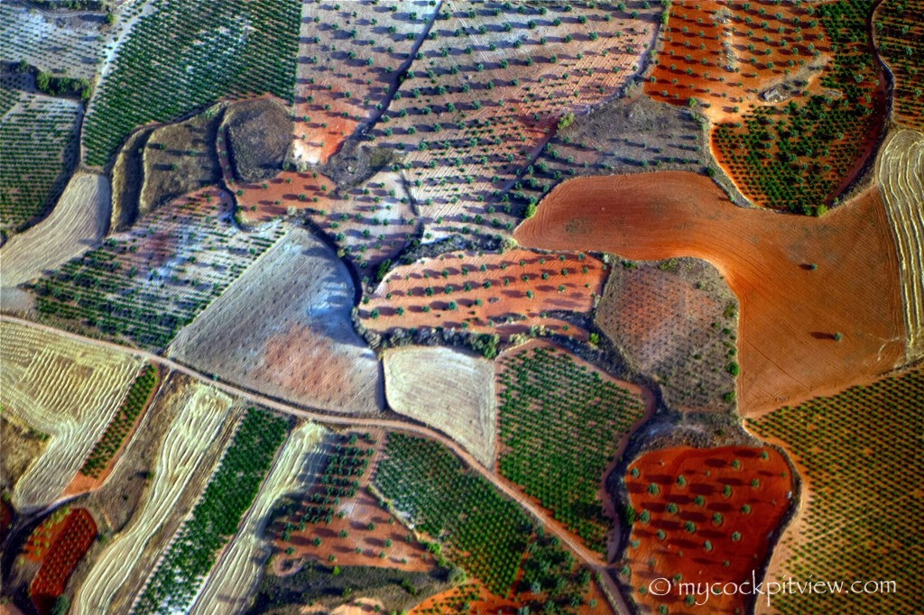 Mycockpitview. This fields are to be seen end of right hand downwind/base leg for runway 36 in Madrid (LEMD). The colors, varying depending if the ground is wet or dry and the texture are quit impressive.