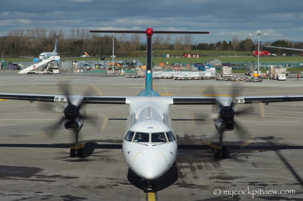 "Mycockpitview. Waiting for our ""taxi"" in Dublin. Luxair Bombardier Dash 8 Q400 taxiing in."