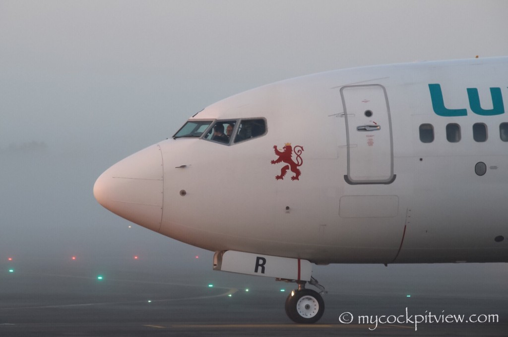 Mycockpitview. Luxair Boeing 737 taxiing to runway 24 in Luxembourg on a foggy spring morning