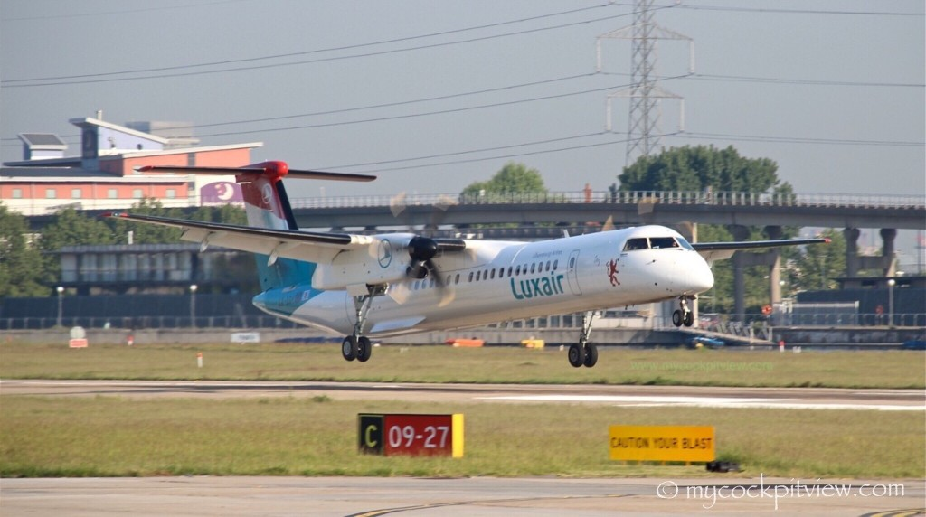 Luxair Bombardier Dash 8 Q400 landing runway 09 at London City Airport. Mycockpitview. EGLC. LCY.
