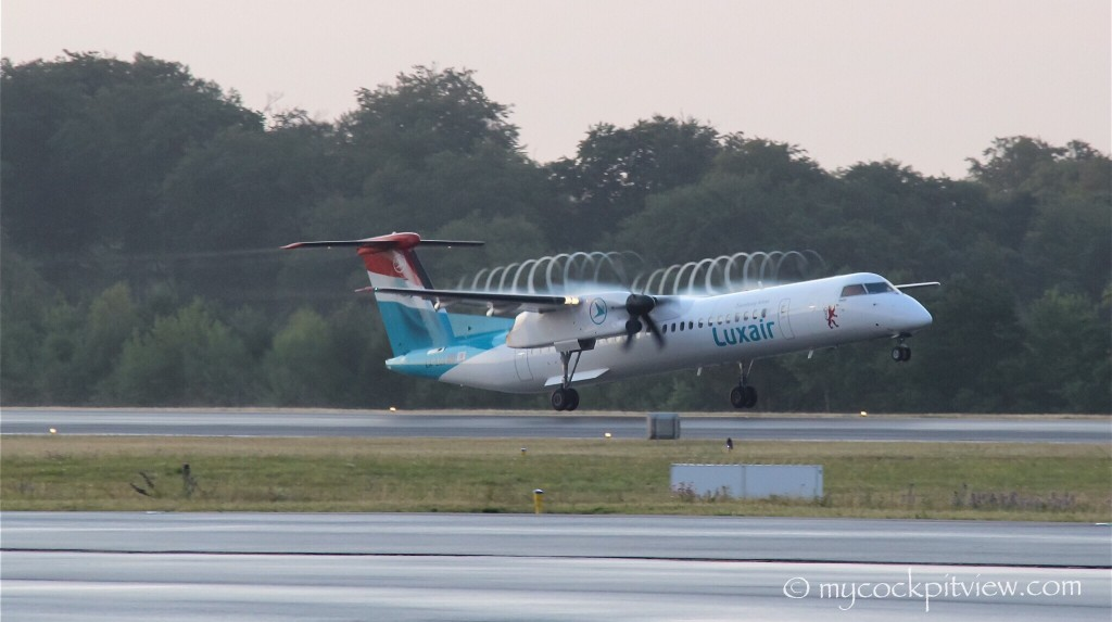 Luxair Bombardier Dash8 Q400 taking off out of Luxembourg in the early morning. Pressure drops at the blade tip, temperature decreases and reaches the dew point, resulting in this condensation... Definitely one of my best Q400 shot so far. Mycockpitview