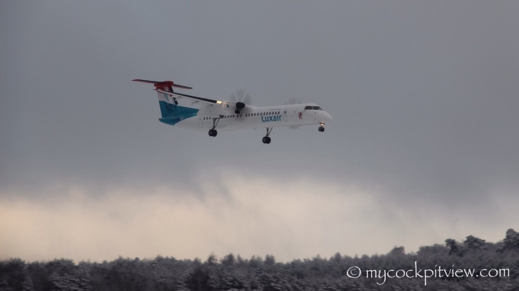 Luxair Bombardier Dash 8 Q400 landing runway 24 in Luxembourg during the winter. Mycockpitview
