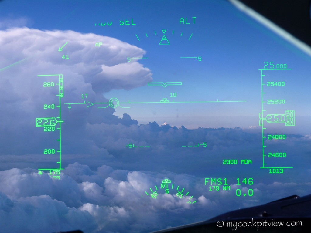 Isolated thunderstorm cloud over Milano. The HGS (Head Up Guidance System) is the perfect tool to see your trajectory
