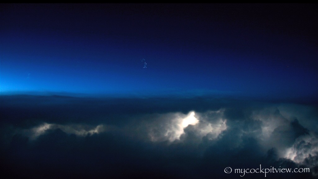 Active thunderstorm at night. Cummulonimbus. Lightning.