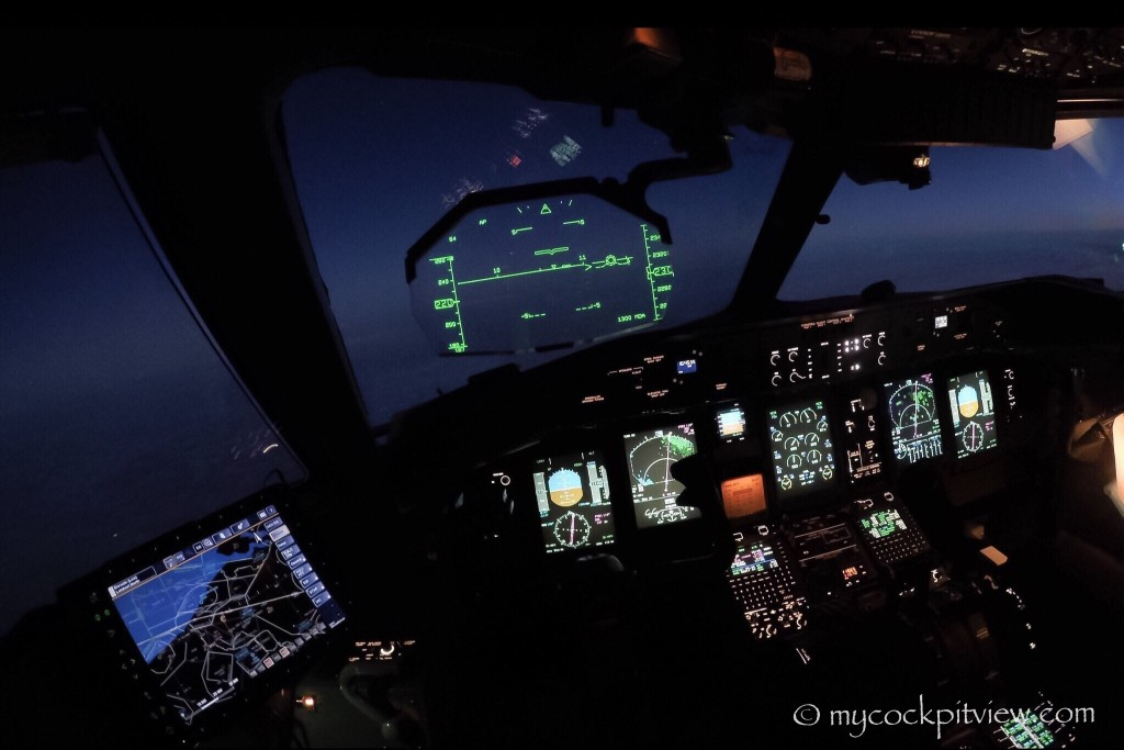 Night cockpit view. Bombardier Dash8 Q400. Luxair.