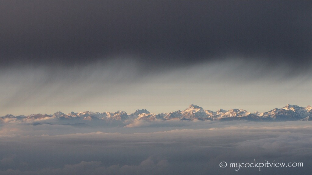 Glimpse on the Alps between two cloud layers