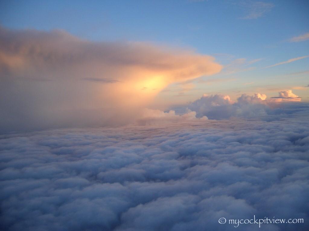 Sunset illuminating the top of a cumulonimbus cloud