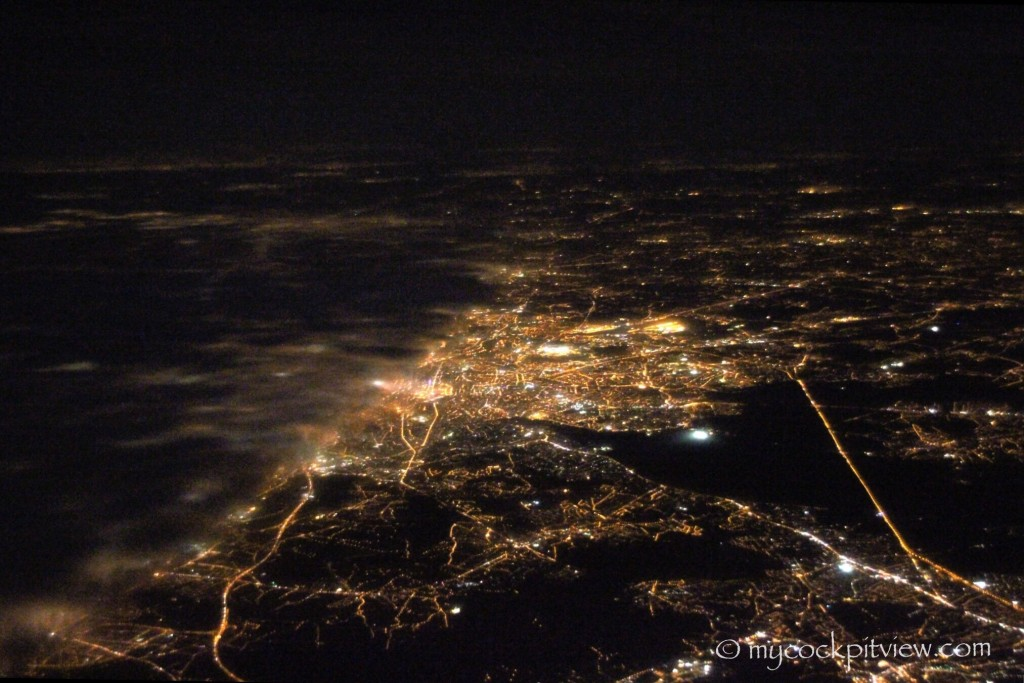 Brussels by night, the western part being covered by fog. Mycockpitview