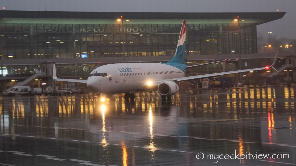 Luxair Boeing 737-800 leaving Luxembourg's apron on a very wet morning. ELLX. LUX. Mycockpitview