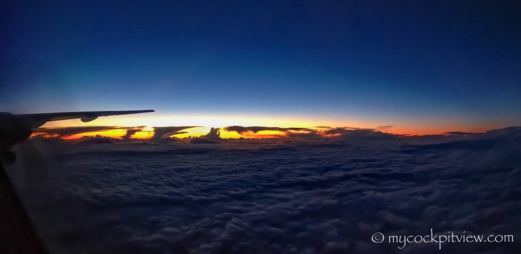 Dying cummulonimbus at sunset. Mycockpitview. Sunrise sunset.