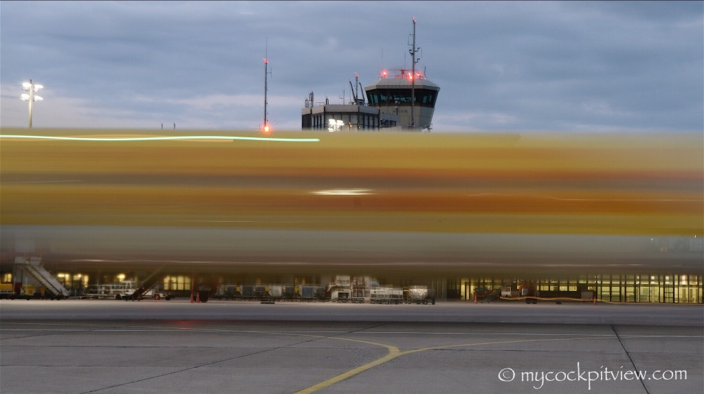 Long exposure picture of a TUI Boeing 737 taxiing out of Berlin Tegel. Mycockpitview