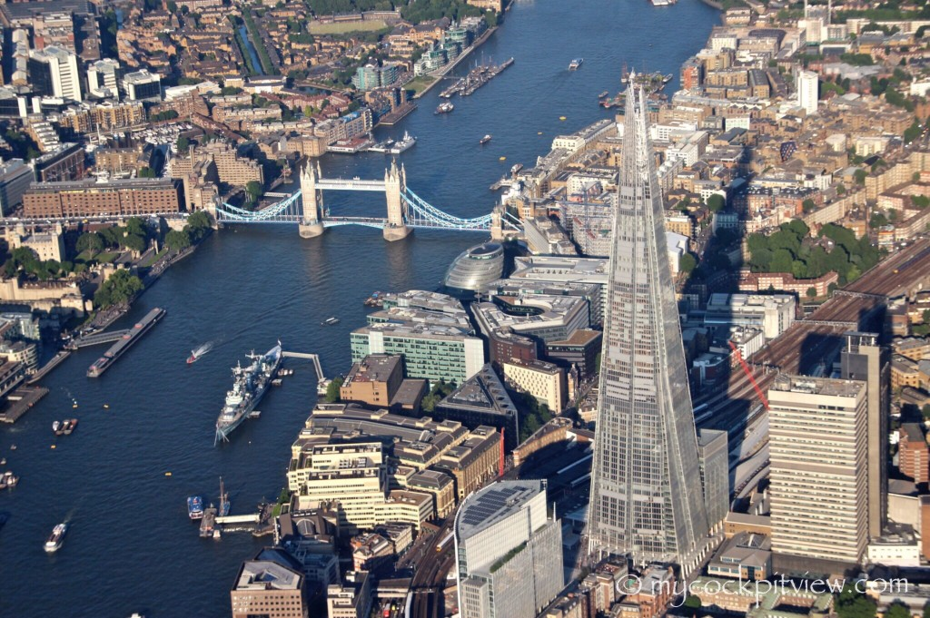 The Tower Bridge and the Shard, while overflying London at 2000 ft during the approach in London City. Mycockpitview