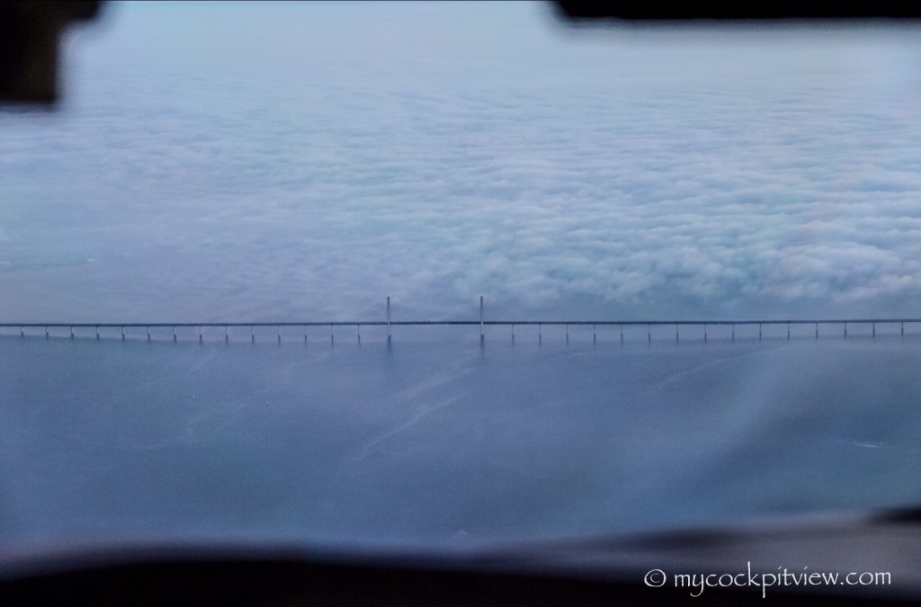 Two different views on the Øresund Bridge.  This bridge is the longest combined road and rail bridge in Europe and connects two major metropolitan areas: Copenhagen, the Danish capital city, and the Swedish city of Malmö.