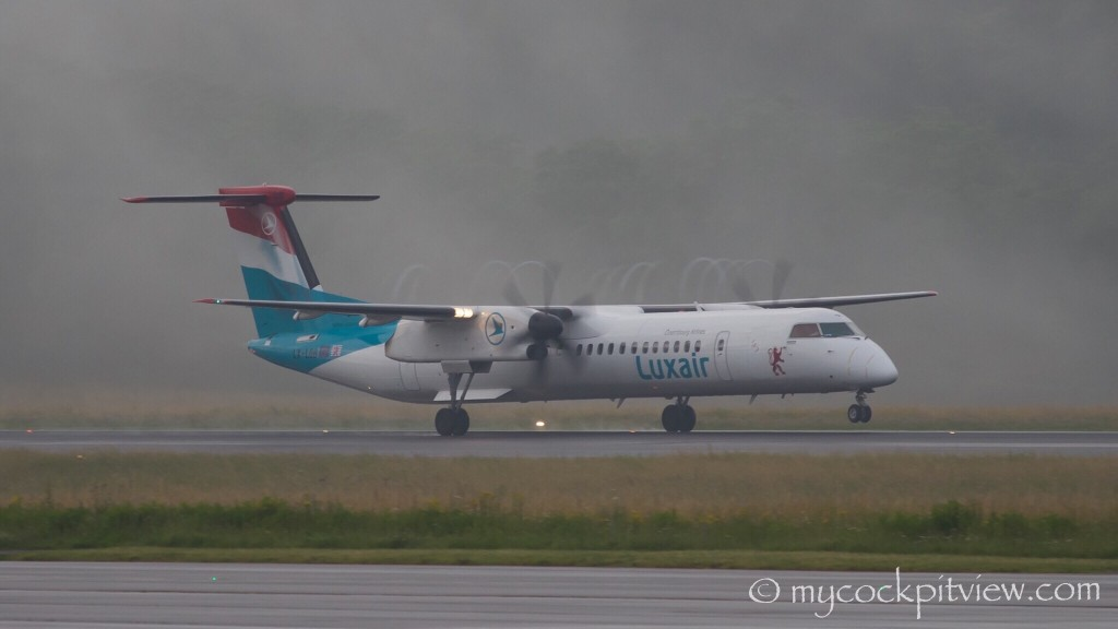 Luxair Bombardier Dash8 Q400 starting it's rotation runway 24 in Luxembourg. Very humid air on a cold morning. Mycockpitview