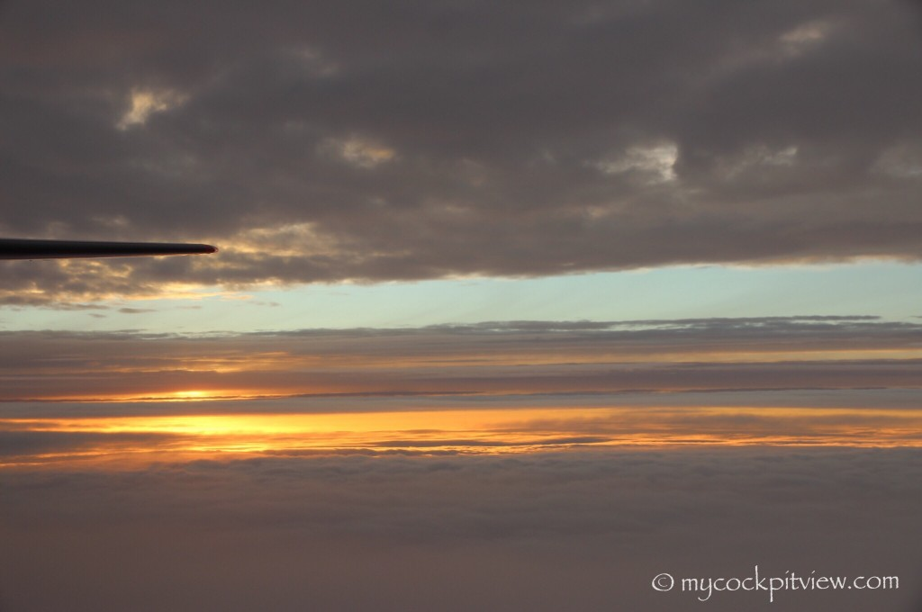 Flying inbetween cloud layers during sunrise. Mycockpitview