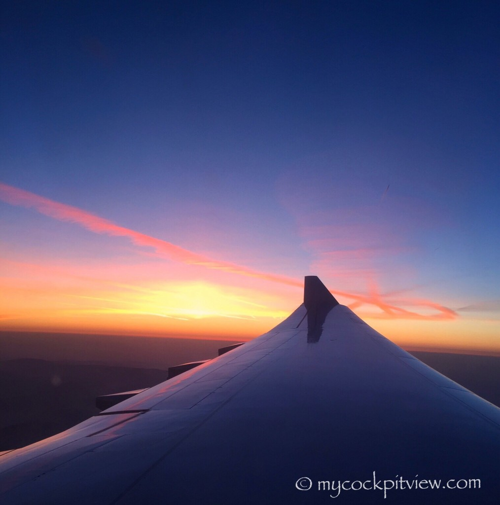 Sunset high above earth, Airbus A340. Mycockpitview
