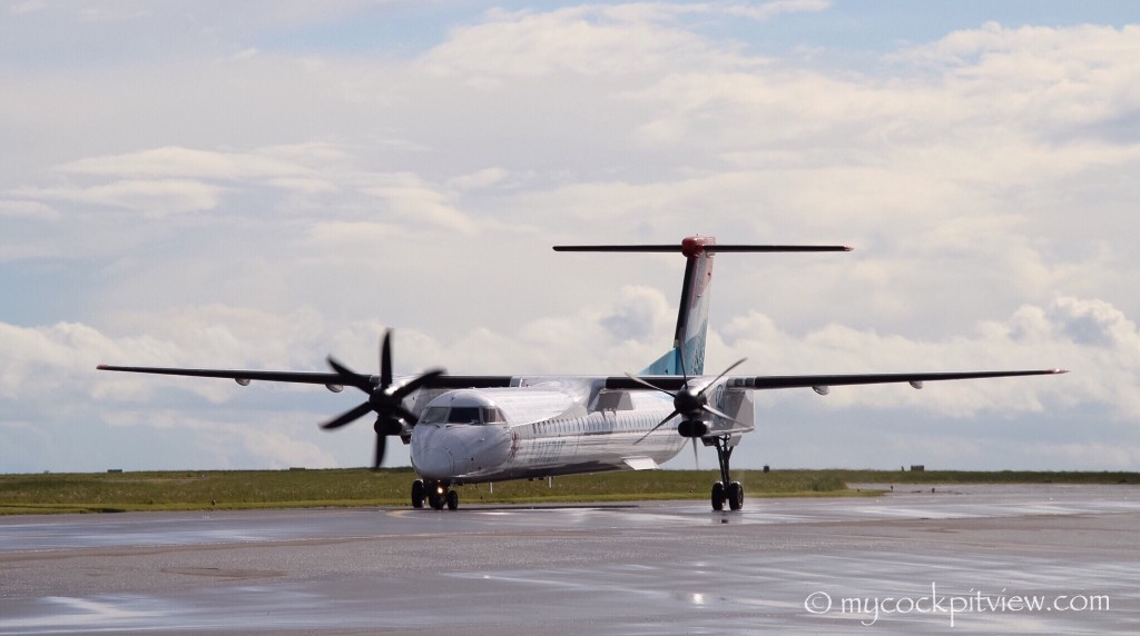 To save fuel after landing, an engine is shut down during taxi. We can clearly see on this photo the difference between the left prop, completely feathered after the shutdown, on the right one, in fine pitch. Luxair Bombardier Dash8 Q400 in Luxembourg. Mycockpitview