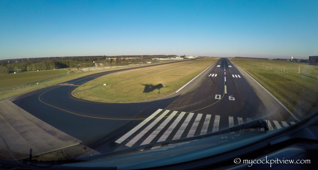 Catching our shadow while landing runway 06 in Luxembourg, mycockpitview, runway