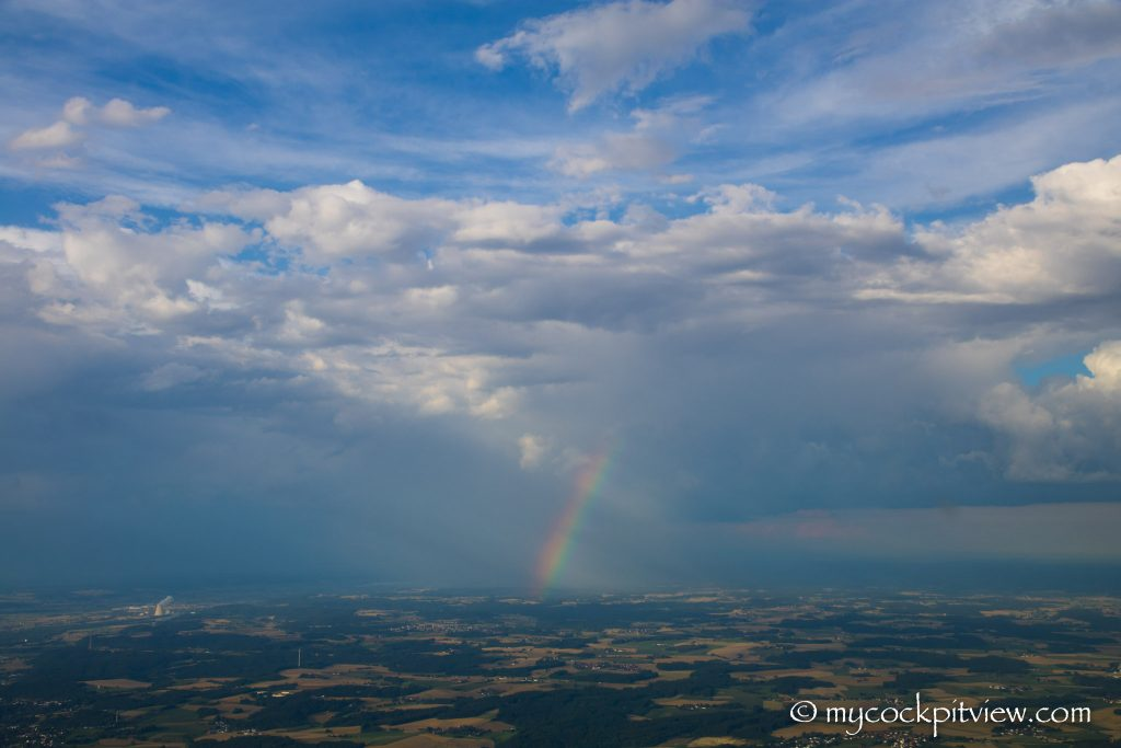 Rainbow during a rain shower, somewhere over Germany, Mycockpitview